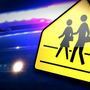 Child struck by tractor trailer while going to board school bus