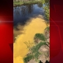 Yellow road paint leaking into Fond du Lac River