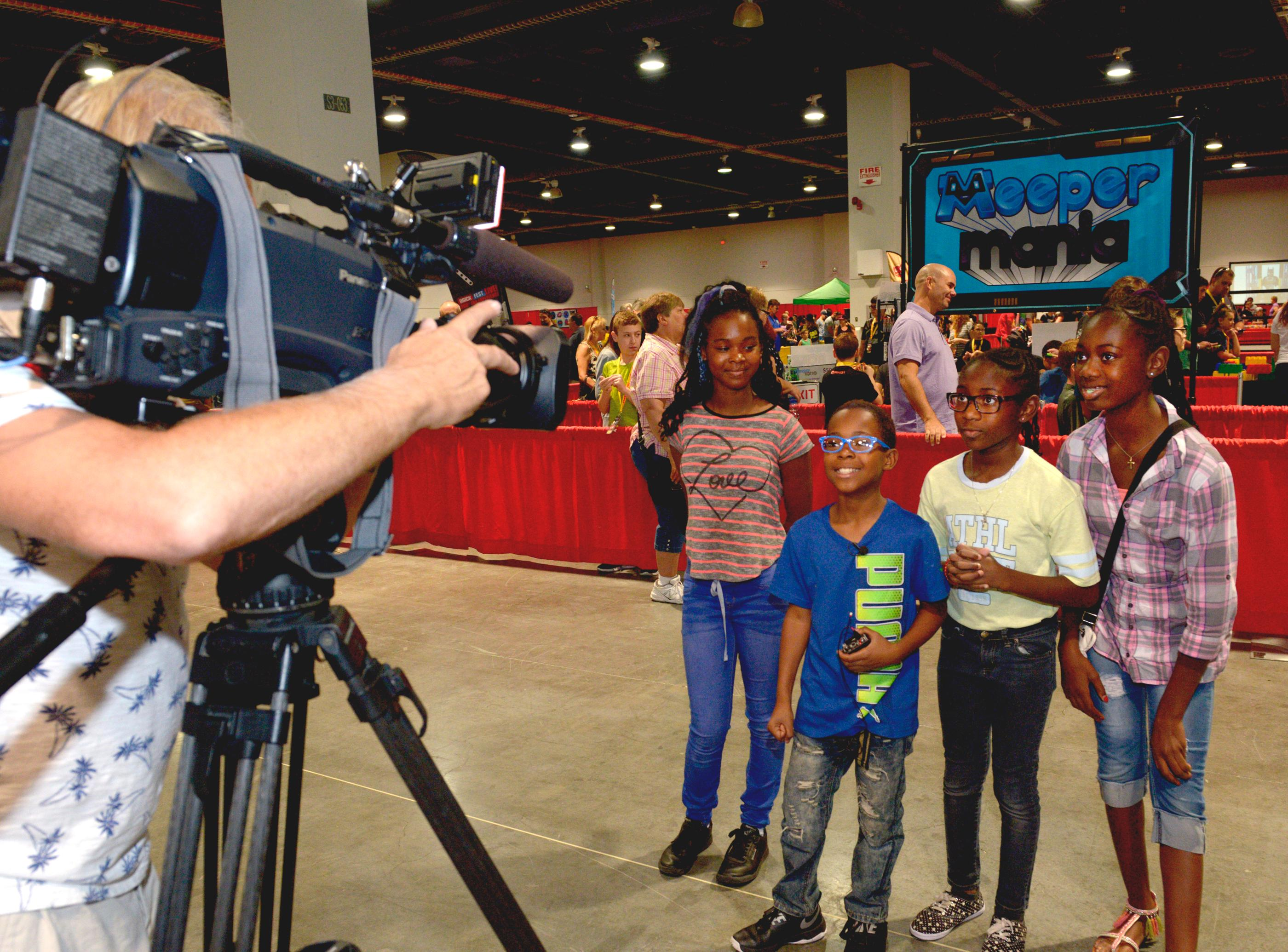 Fans (l-r) Jayla Williams, Jaron Williams, Ogechi Godspower and Nneoma Godspower are interviewed during the Brick Fest Live Lego Fan Experience at the Las Vegas Convention Center, September 9, 2017. [Glenn Pinkerton/Las Vegas News Bureau]