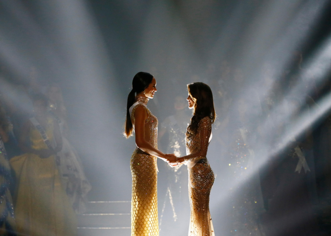 Iris Mittenaere of France, right, and Raquel Pelissier of Haiti hold hands moments before the winner was announced in the Miss Universe 2016 coronation Monday, Jan. 30, 2017, at the Mall of Asia in suburban Pasay city, south of Manila, Philippines. Mittenaere was crowned the Miss Universe 2016. (AP Photo/Bullit Marquez)